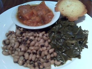"Most excellent greens, yummy but cloyingly sweet ""yams,"" marginal peas and cornbread. About $10."